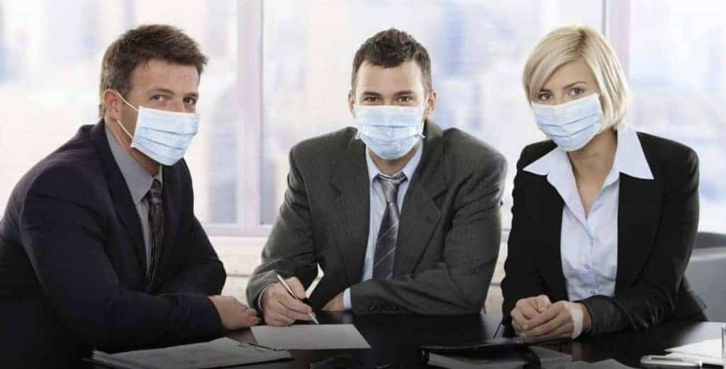 Business people fearing sick building syndrome